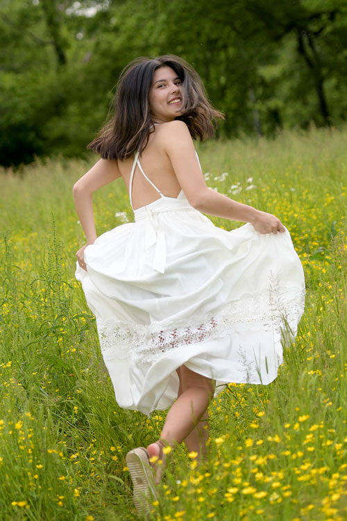 Girls Senior Pictures in Yellow Flower Field in Madison, AL